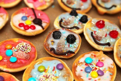 5707938 funny pastry with faces for kids birthday party